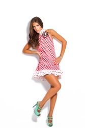 young fashion model in summer dress and high heel shoes studio white