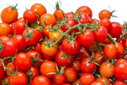 Background of the wet cherry tomatoes on a white background