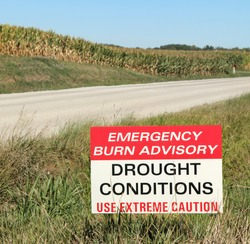Drought conditions advisory sign along a rural road