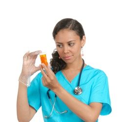 Female doctor, nurse looking at the container with some pills.  isolated on white
