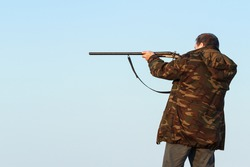 Adult male hunter aiming the hunt during a hunting party