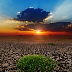 dramatic sunset over barren earth