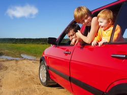 children with father in car