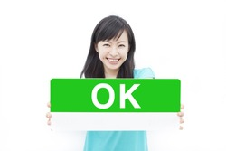 "beautiful young woman showing ""OK"" sign, isolated on white background"