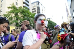 TORONTO-JUNE 25: A protester dressed as a clown  during the G20 Protest on June 25  2010 in Toronto, Canada.