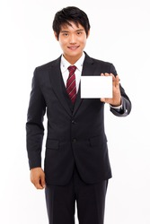 Business man with blank card isolated on white background.
