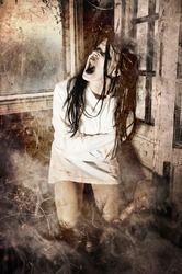 Grunge Horror Scene of a Woman Possessed Screaming Wearing a Straight Jacket