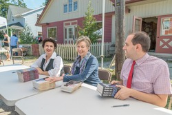 EDEN MILLS, ON - SEPTEMBER 16:  Prize winning Canadian writers, Teresa Toten, Pat Bourke and Evan Munday, sign their books at the annual Writers Festival in Eden Mills, Ontario on September 16, 2012.