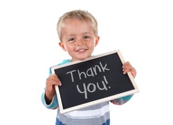 Young child holding thank you sign standing against white background