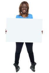 African girl model holding blank billboard. Full length shot