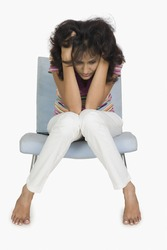 Woman sitting on a chair and looking depressed