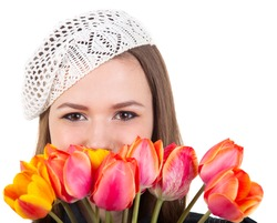 Young cute brunette girl in parisian style with tulip flowers