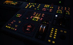 Illuminated ship control panel in the dark.