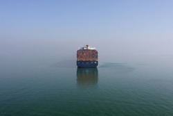 Aft of the large container ship at anchor at Bitter Lake, Suez Canal