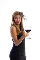 Beautiful woman with a glass of vine - Attractive young woman in a little black dress, with a large tall wine glass on white background
