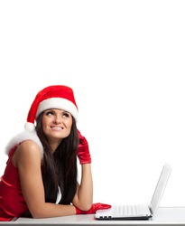 christmas female santa on a laptop computer isolated over a white background.beautiful girl in a suit Santa online store studio white space laptop red gloves  choose gifts online shopping