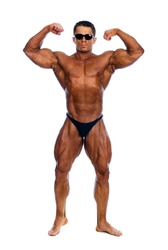 Bodybuilder showing his muscles on a white background.In glasses