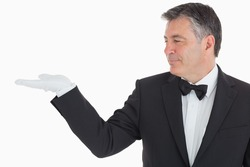 Waiter showing us something in his opened hand