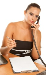 Young businesswoman holding a telephone working in office