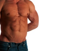 Muscular male torso of bodybuilder at jeans