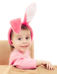 The little girl with pink ears bunny on white background