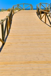 wooden footbridge towards the beach