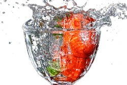 Fresh strawberries dropped to pure water