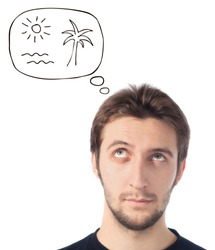 young man looking up dreaming about beach on white background