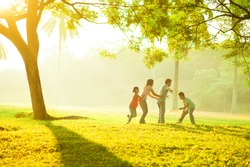 Asian family outdoor quality time enjoyment, asian people playing during beautiful sunrise