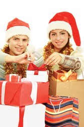 Portrait of young pretty couple holding  red box - christmas gift and looking at camera