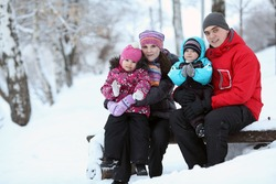 complete family with children walking in winter
