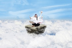 Beautiful young woman multitasking over clouds under blue sky