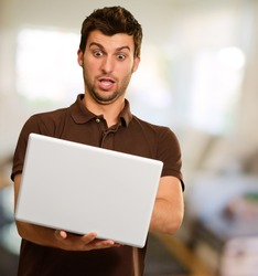 Portrait Of Young Man Working On Laptop, Indoors