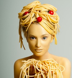made-up girl model with the pasta in the hands