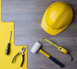 laminate and tools with a yellow helmet