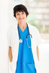 pretty female mature medical doctor portrait in hospital