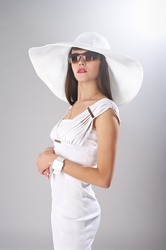Fashionable lady in elegant white clothes