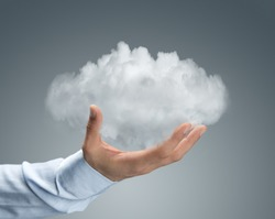 Cloud computing, close up of male hand holding cloud with copy space