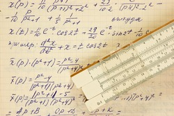 Page of old vintage paper with the calculation of the mathematics and slide rule