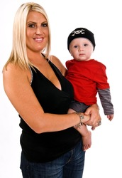 Beautiful young, blonde, female holding her son