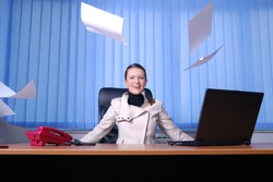 .young businesswoman throwing documents | STRESS CONTROL, FREEDOM AND HAPPINESS CONCEPT
