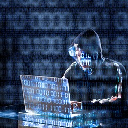 Hacker typing on a laptop with binary code in background
