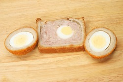 Gala pork pie and Scotch egg on wood