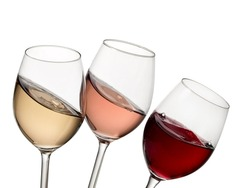 Three glasses with red, rose and white wine