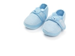 Baby boy blue shoes isolated on white background
