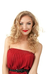 Portrait of blond long hair girl in red dress