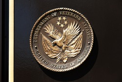 WASHINGTON, DC - APRIL 5: Bronze plaque at the Department of Veterans Affairs on April 5, 2013 in Washington, DC.