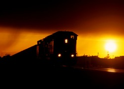 A coal train at sunset.