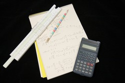 mathematical exercise with pencil,calculator and sliding rule