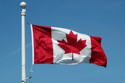 Canadian flag in blue sky background